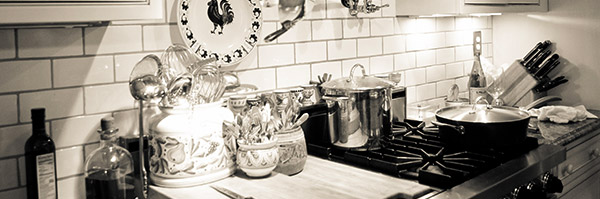 A black and white photo of the Just Simply... Cuisine Kitchen